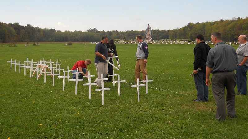 seminarians assemble cross display at shrine